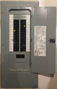 open breaker box with labeled circuit breakers