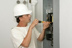 Electrician Working to replace a circuit breaker