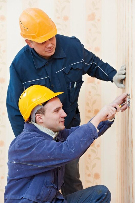 Electricians performing electrical service