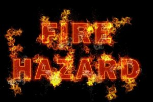 electrical service by local electricians advises of fire hazards - flames enveloping the words FIRE HAZARD